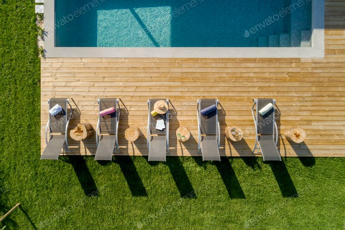 Aerial view of chairs in garden with pool and deck
