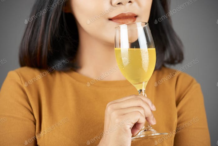 Woman smelling juice
