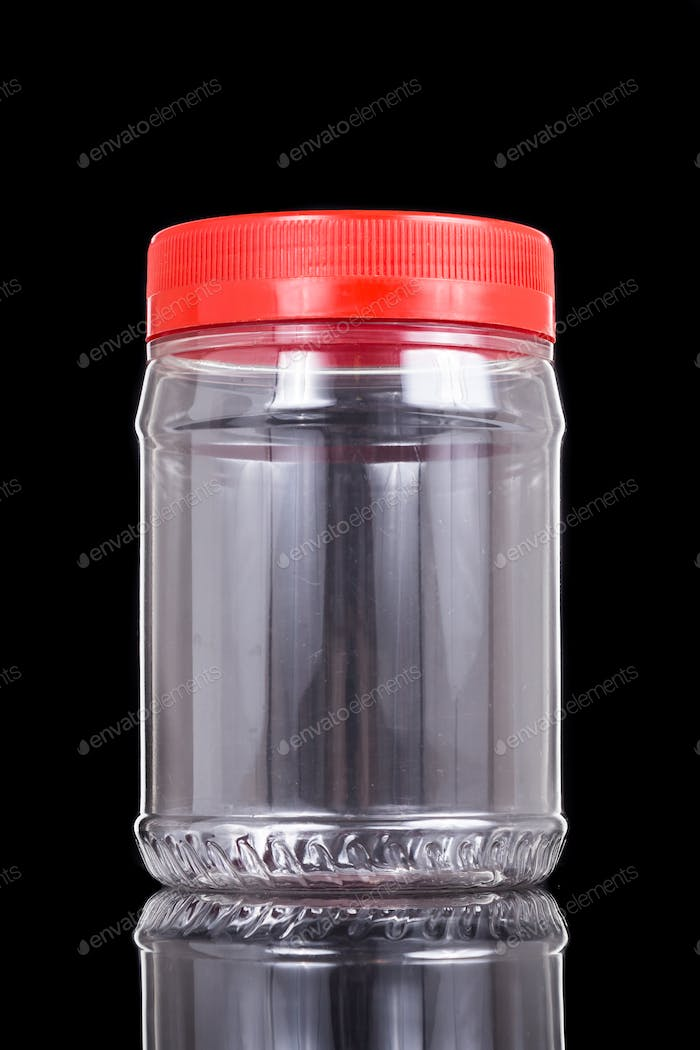 Large translucent plastic PVC jar with red cover isolated in black