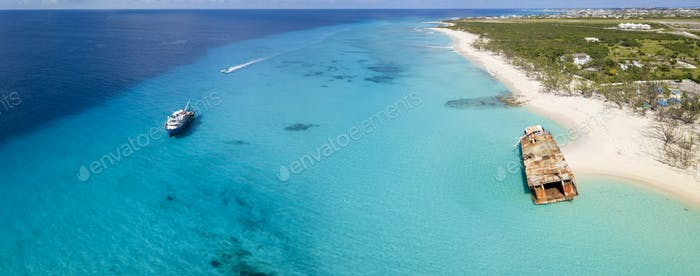 Aerial panorama of Grand Turk with clear water, boats, and shipw