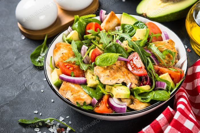 Salad with Grilled chicken, green leaves and vegetables