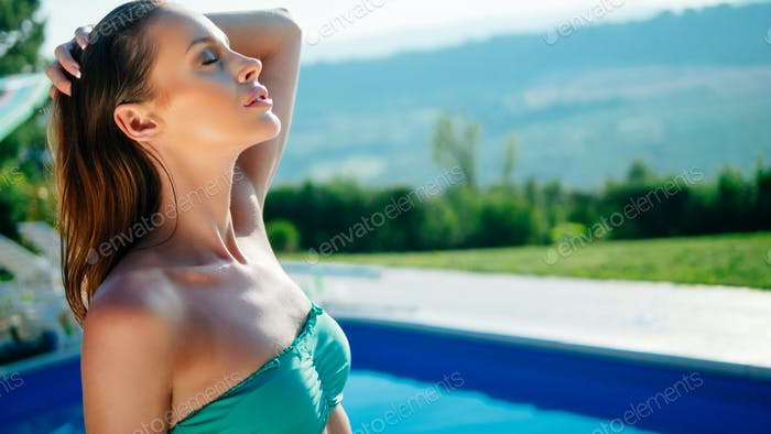 Beautiful woman enjoying swimming pool