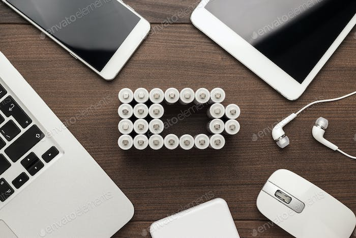 Conceptual Image Of Battery Charge Level Pictogram And Mobile Devices
