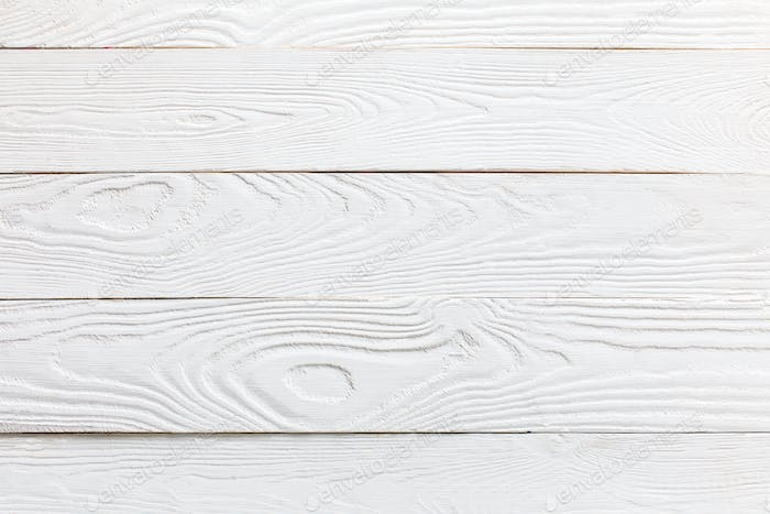 horizontal view of white wooden tabletop