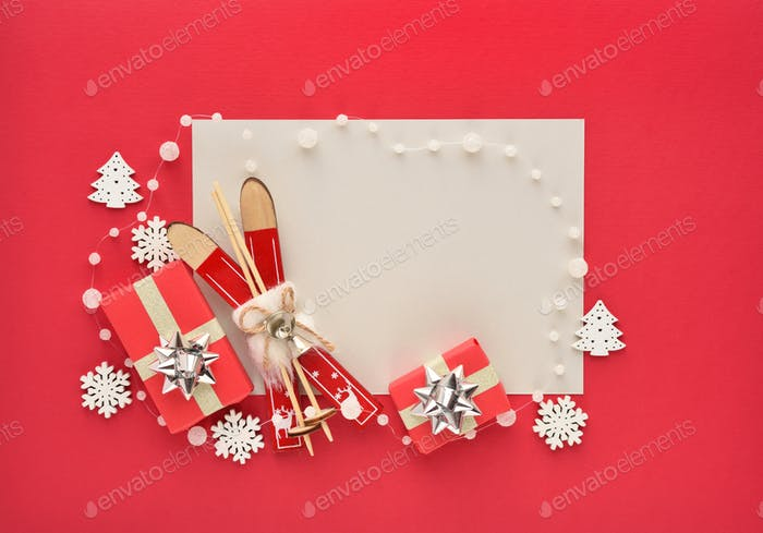 Christmas or New Year greeting card. Christmas decorations and gifts on red background