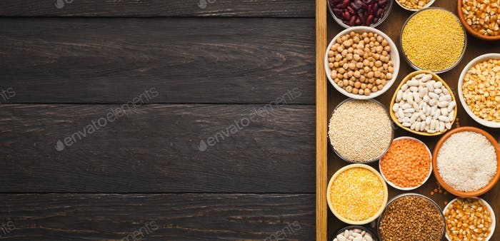 Various gluter free groats on wooden background, copy space
