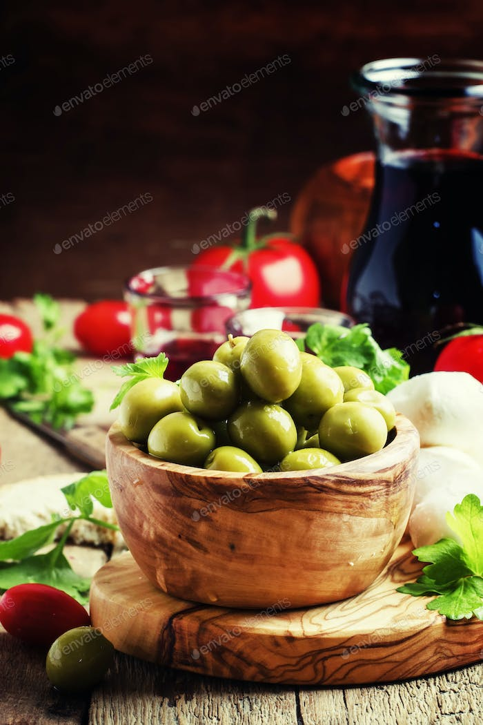 Green olives in a wooden bowl