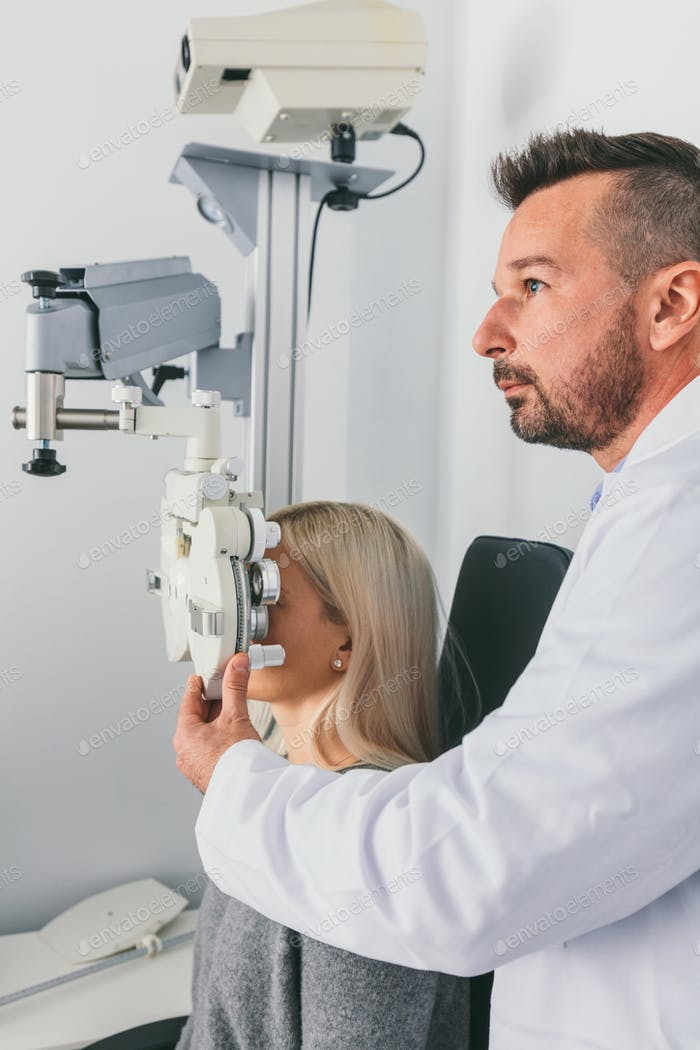 Doctor examining his patient's sight.