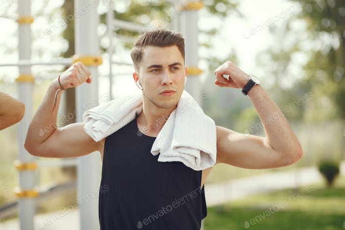 Handsome man training in a summer park