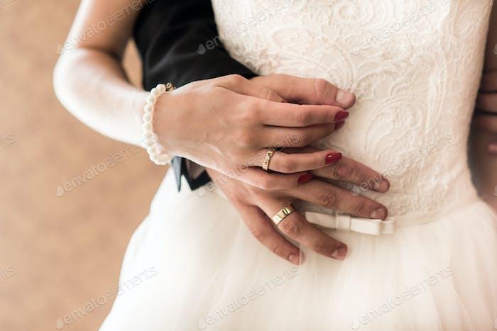 the bride and groom held hands