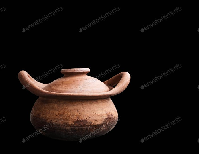 clay pot on black background