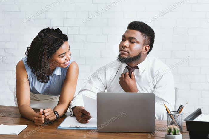 Attractive black guy sexually harassed by his female collague at workplace