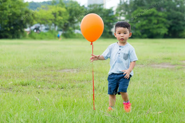 Little boy play with balloon at outdoor