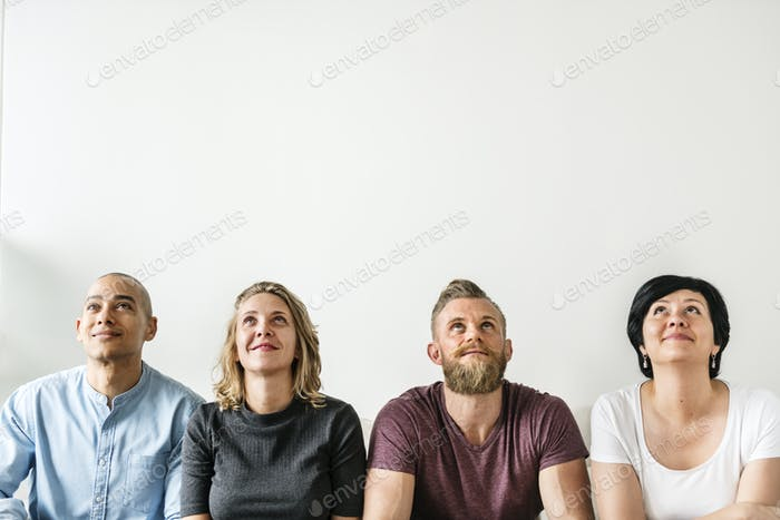 Diverse people sitting with thoughtful face expression