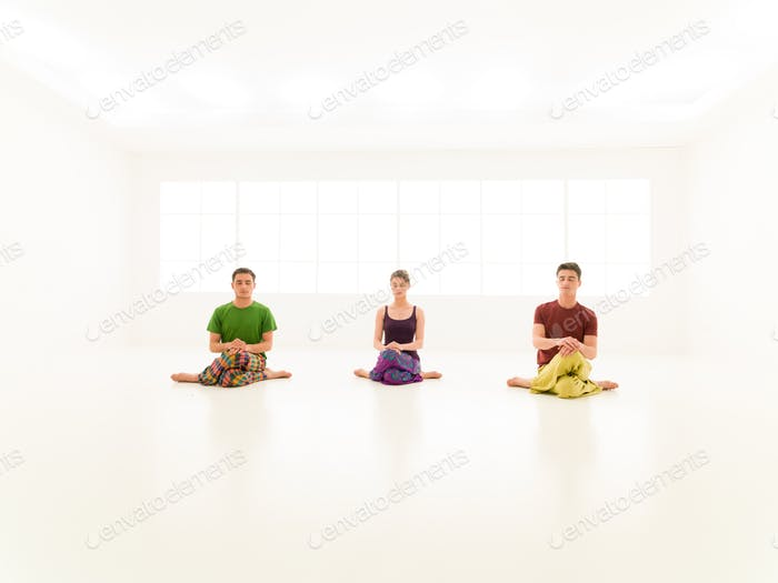three casual people yoga class