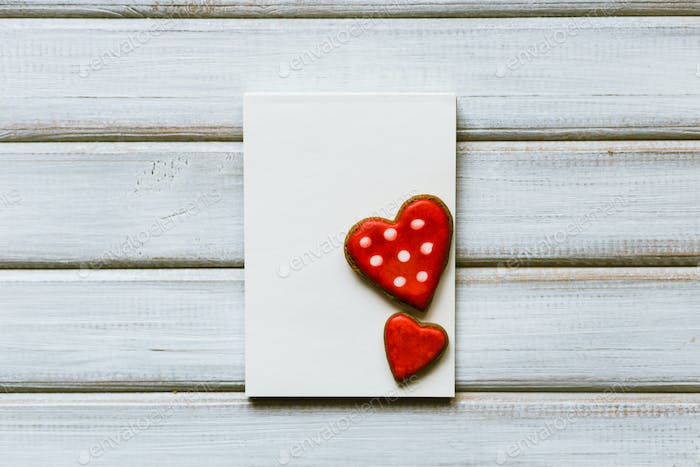 Blank greeting card with cookies in the shape of heart. Valentine concept