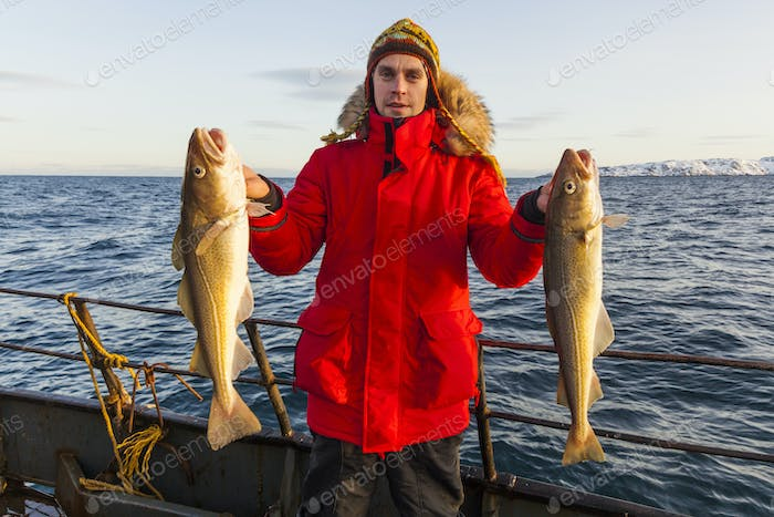 Fisherman on boat with in winter