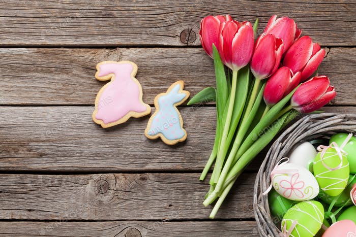 Red tulip flowers and Easter cookies and eggs