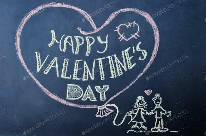 happy Valentines day written on the chalk Board.