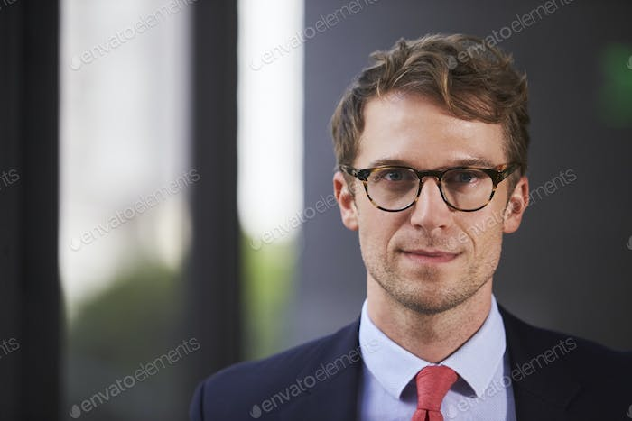 Young white businessman, head and shoulders close up