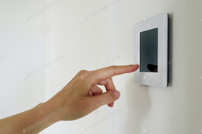 Hand using Air ventilation controller with display