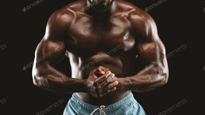 Well fir athletic body of african male bodybuilder