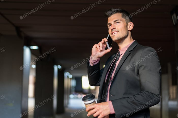 man close up with a mobile phone and coffee