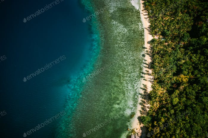 Palawan, Philippines, El Nido. Aerial drone top down view of a secluded deserted tropical beach with