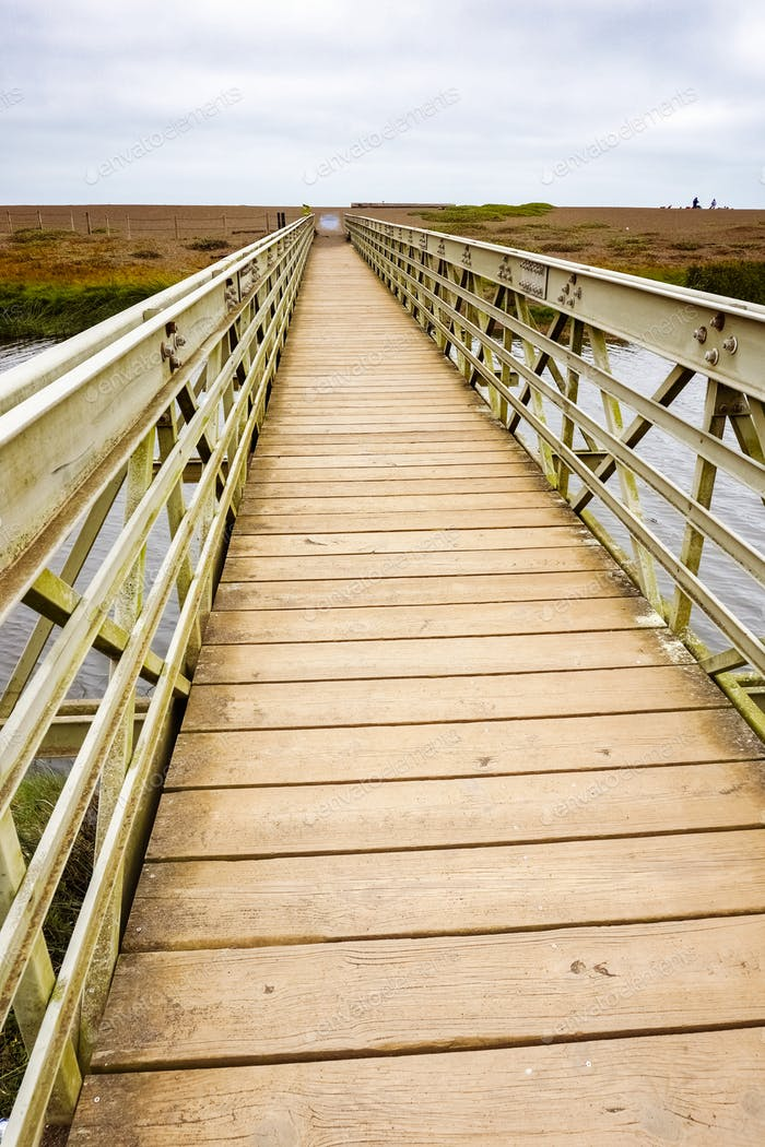 Wood and metal bridge crossing the Rodeo Lagoon