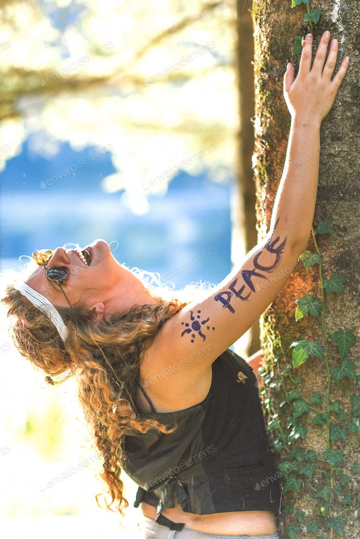 Pretty free hippie girl laughing. Peace. Body painting. - Vintag