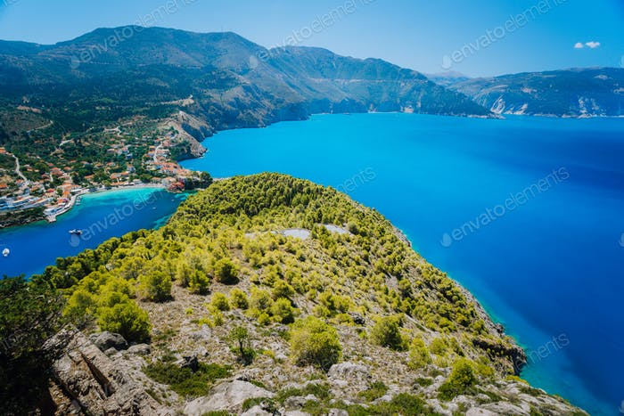 Ultra wide shot of Assos village in morning light, Kefalonia. Greece. Beautiful turquoise colored