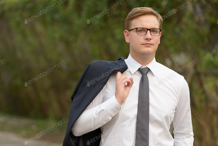 Businessman with blond hair in the streets outdoors