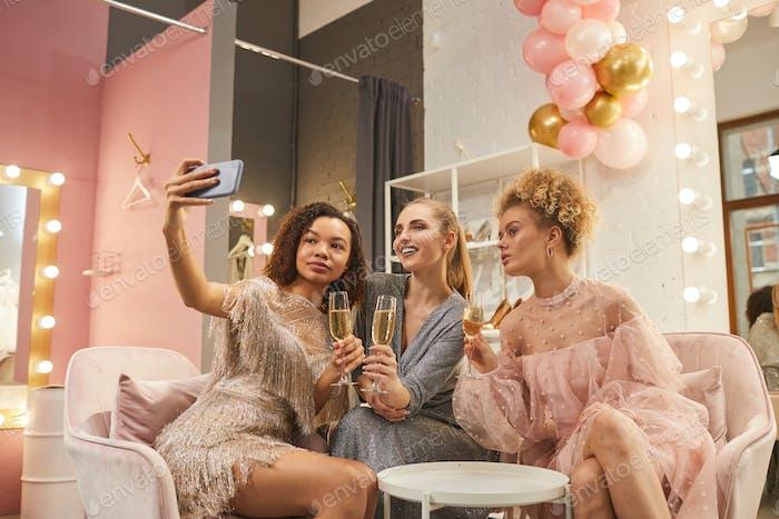 Beautiful Young Women Taking Selfie in Dressing Room