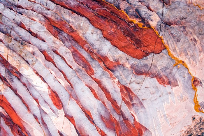 Geological pattern with white and red stripes