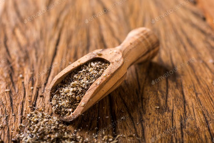 Ground chia seeds in wooden scoop