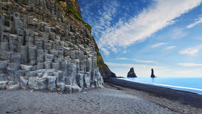 landscape with basalt rock formations Troll Toes on Black beach Reynisfjara near the village of Vik