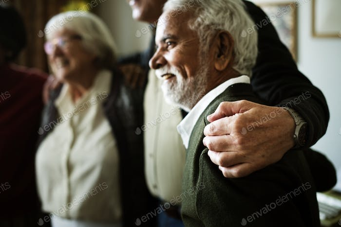 Senior adults arms around each other's shoulder