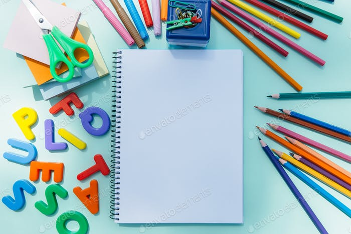Notepad with different colorful pencils