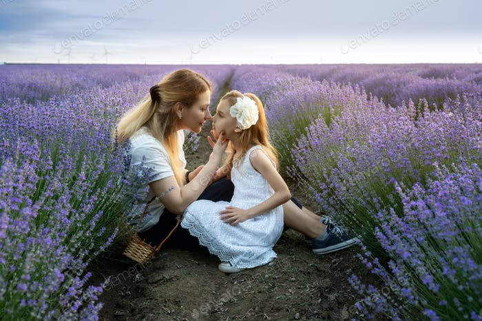 Mother and daughter in a lavender field