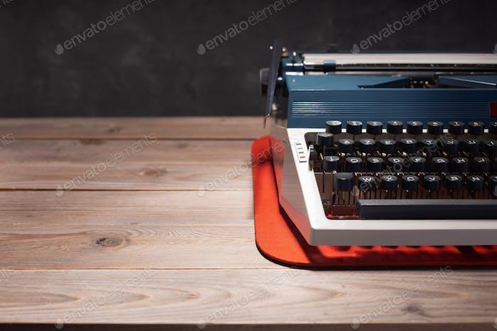 vintage typewriter at wooden top table