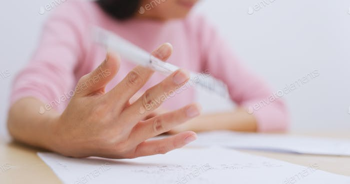 Woman study at home and feeling stress, palm sweating