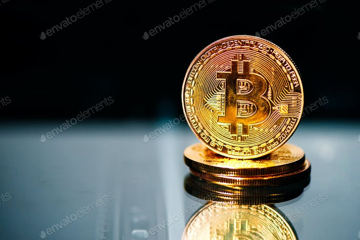 Bitcoins on reflective surface