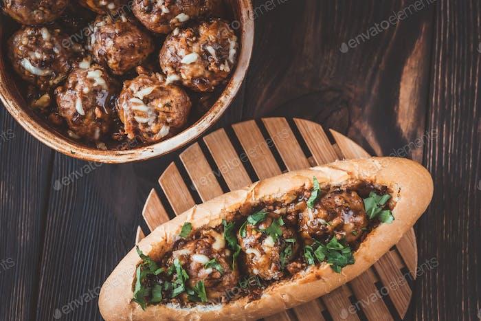 Hot dog bun stuffed with meatballs