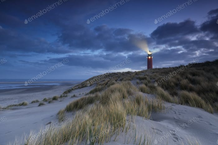 lighthouse on dune in dusk