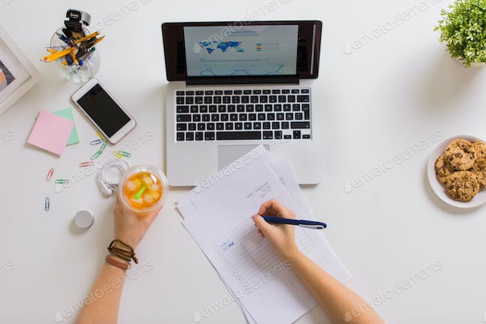 woman hands with papers and cup of drink at office