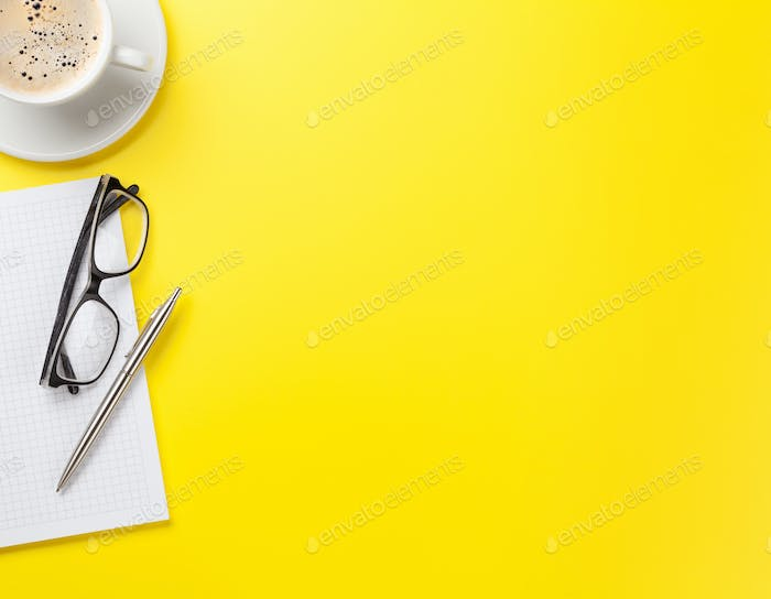 Office yellow backdrop with coffee and supplies