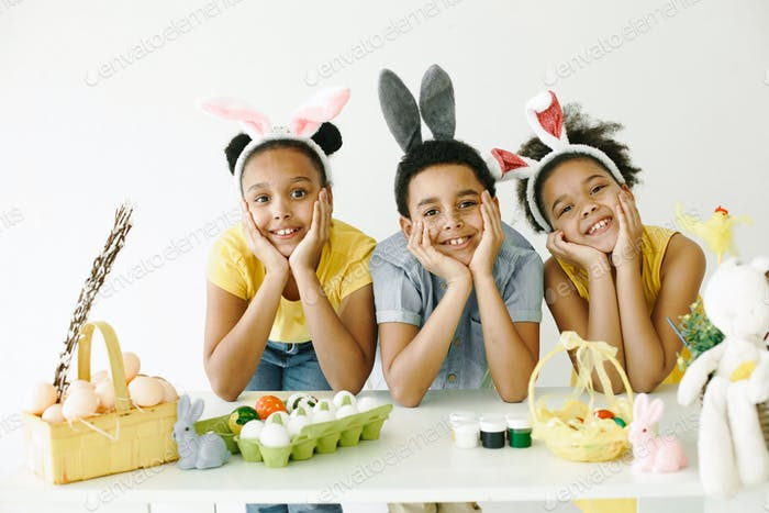 Happy kids posing for a photo in rabbit ears