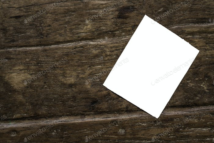 Note mockup template on wooden table