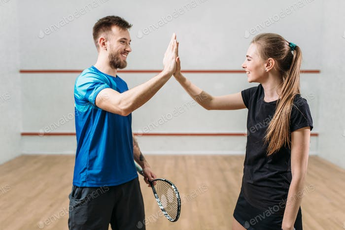 Squash players with rackets after match