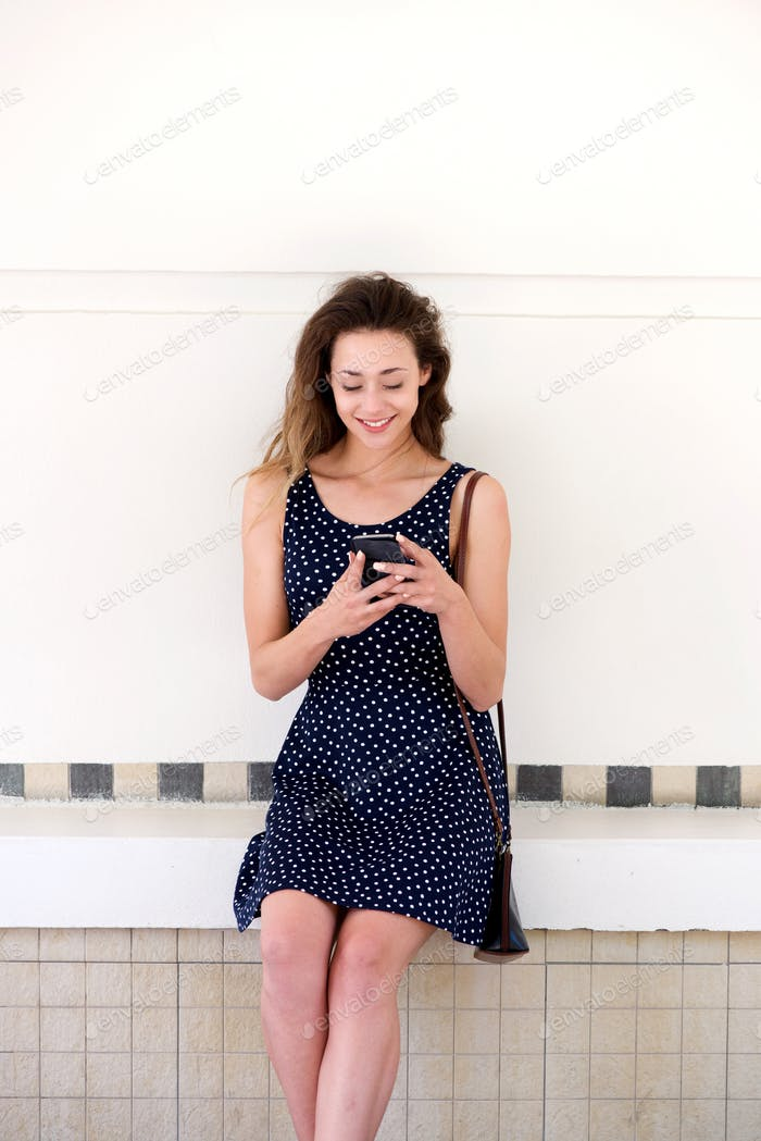 happy woman relaxing outside with smart phone